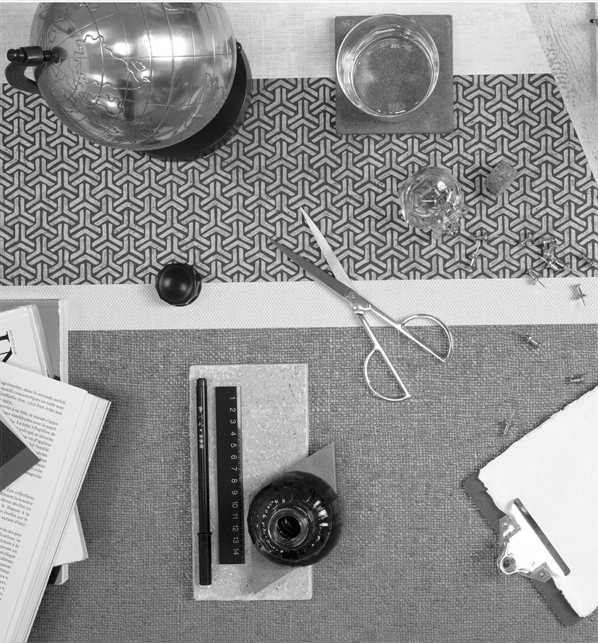 Fabric swatches and measuring tools on desk