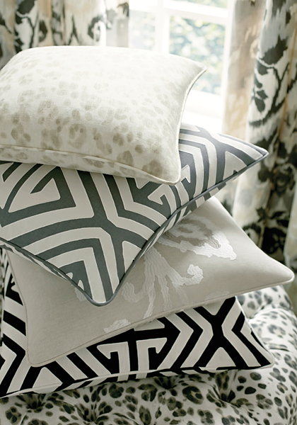 A stack of throwpillows in contrasting prints
